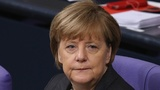 Germany's Merkel stands by refugee policy after attacks