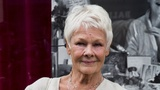 Dame Judi Dench gets tatted up at 81