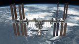 Soyuz capsule docks with International Space Station