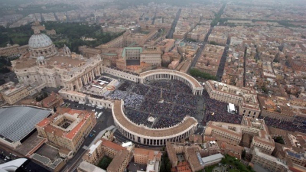 Why Is Sanders In Vatican City Not New York City?