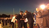 Student with cerebral palsy steps out of wheelchair for first time at graduation