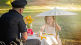 Little girl has tea party with officer who saved her life