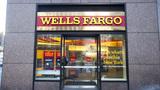 Wells Fargo chief could still walk with $77 million
