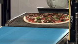 Pizza shop uses robots to make pizzas