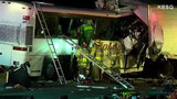 13 killed when California tour bus hits truck