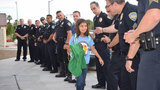 'We have each other': Police escort daughter of fallen officer to school