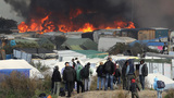 Calais Jungle: Fires rage through camp as migrants torch shelters