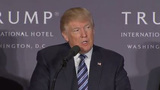 Trump mixes business and politics with opening of new hotel