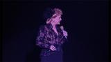 Debbie Reynolds performs on stage